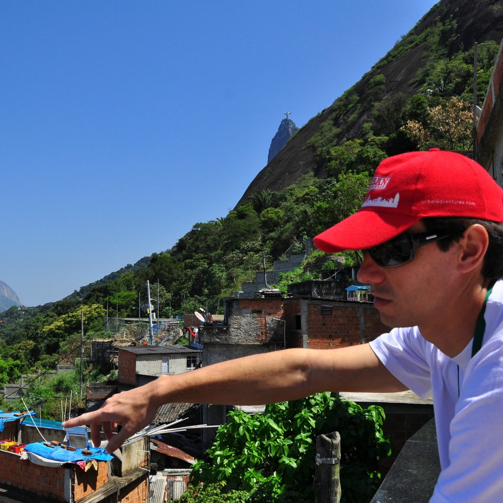 tour leader pointing out sites on a favela tour