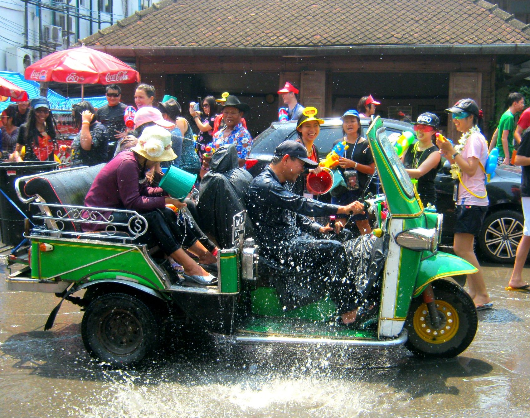 tuk-tuk in the streets during water festival in chiang mai