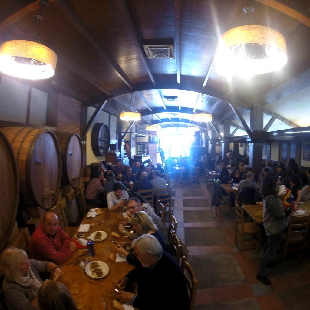 crowd of people inside a cider house