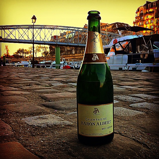 bottle of champagne at paris sunset
