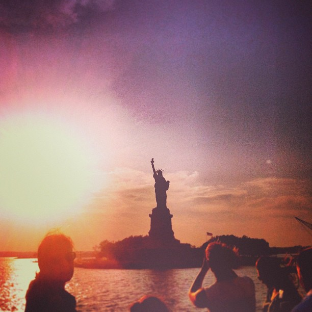 statue of liberty at dusk in nyc