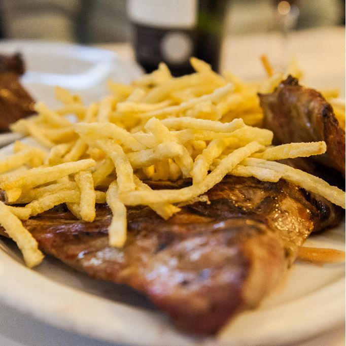 steak topped with fries served in buenos aires
