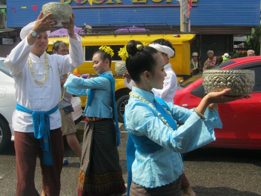 carrying baskets at songkran
