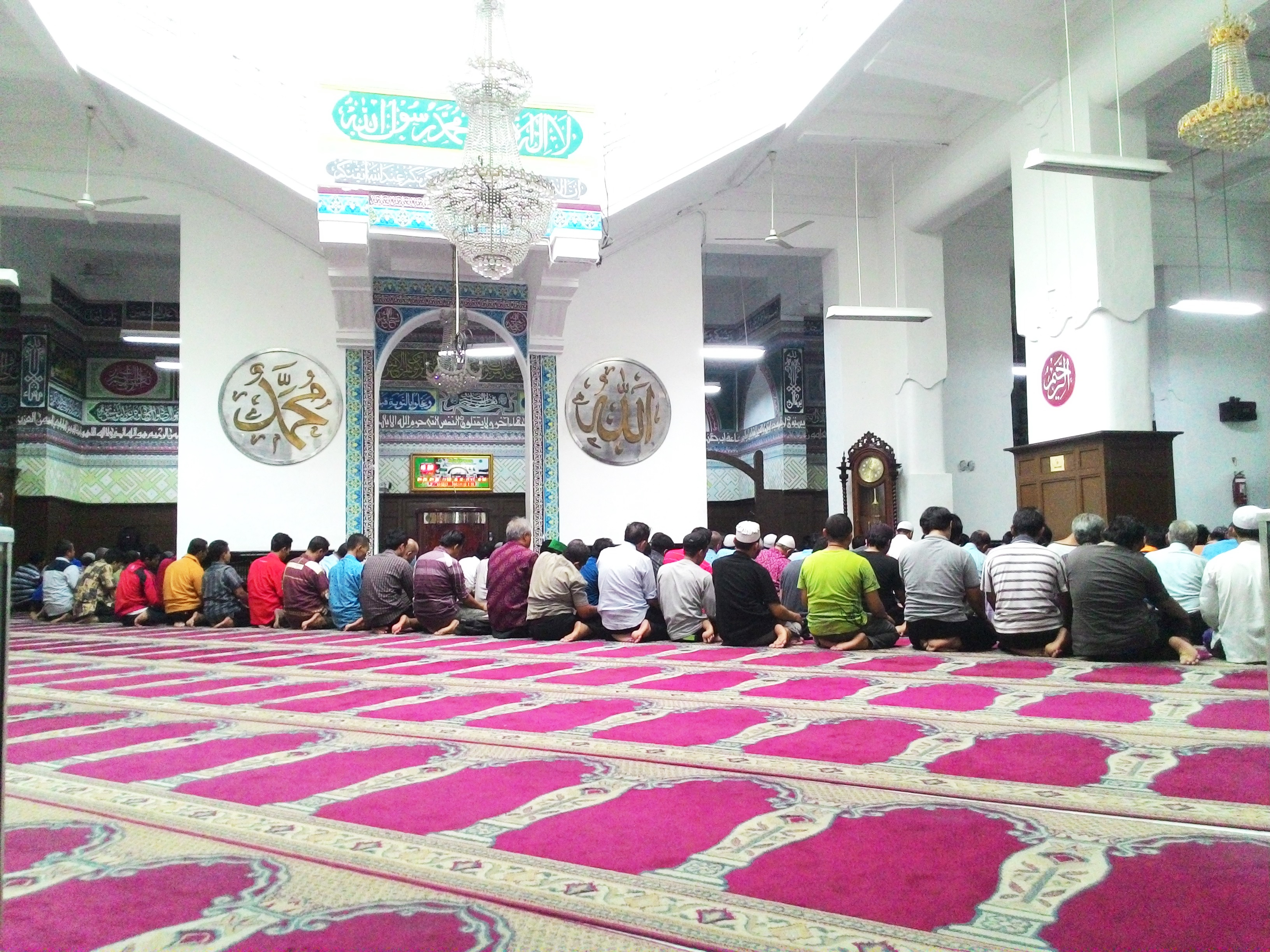 Men praying at the Cut Meutia Mosque in Jakarta