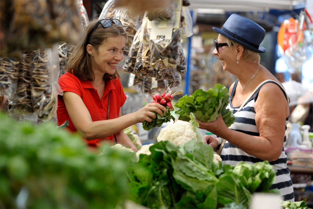 shopping for produce in a farmers' market