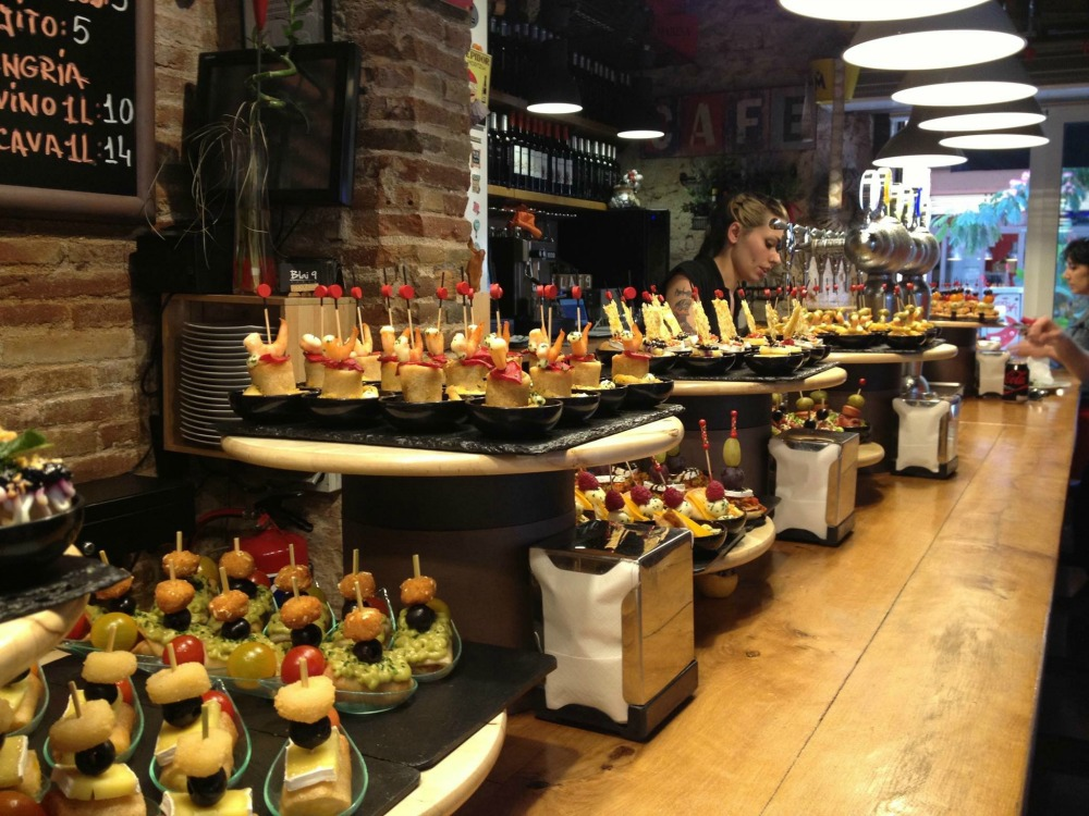Counter full of tapas on display in Barcelona