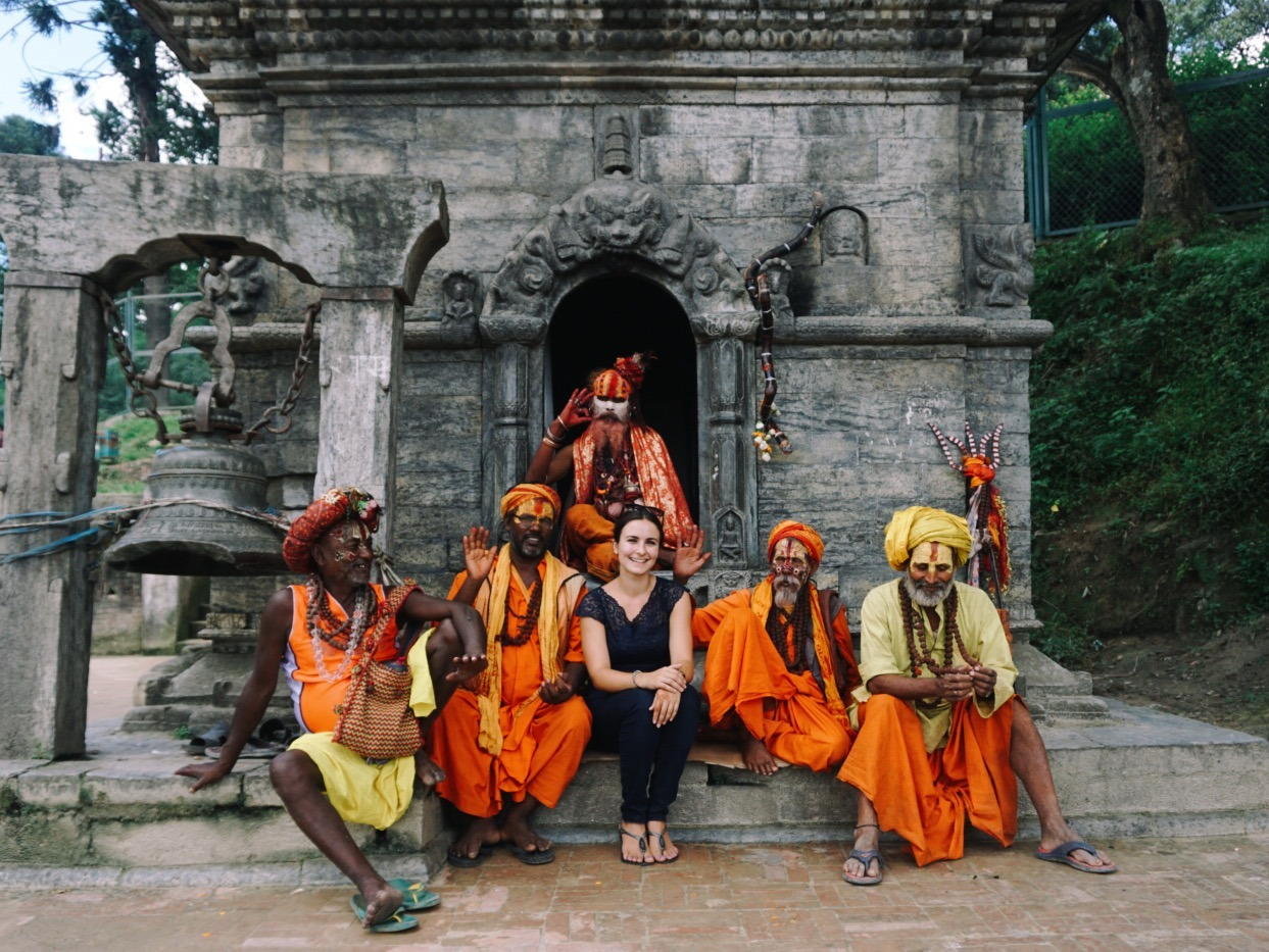 traveller sitting with spiritual men in Nepal
