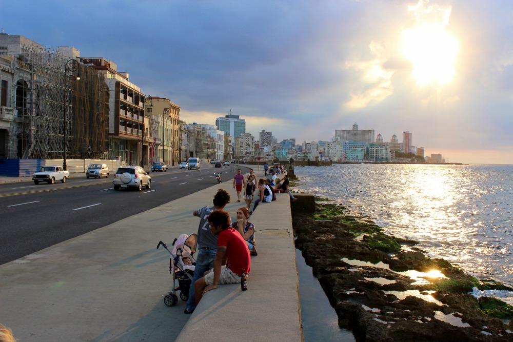 people along the seawall in Havana