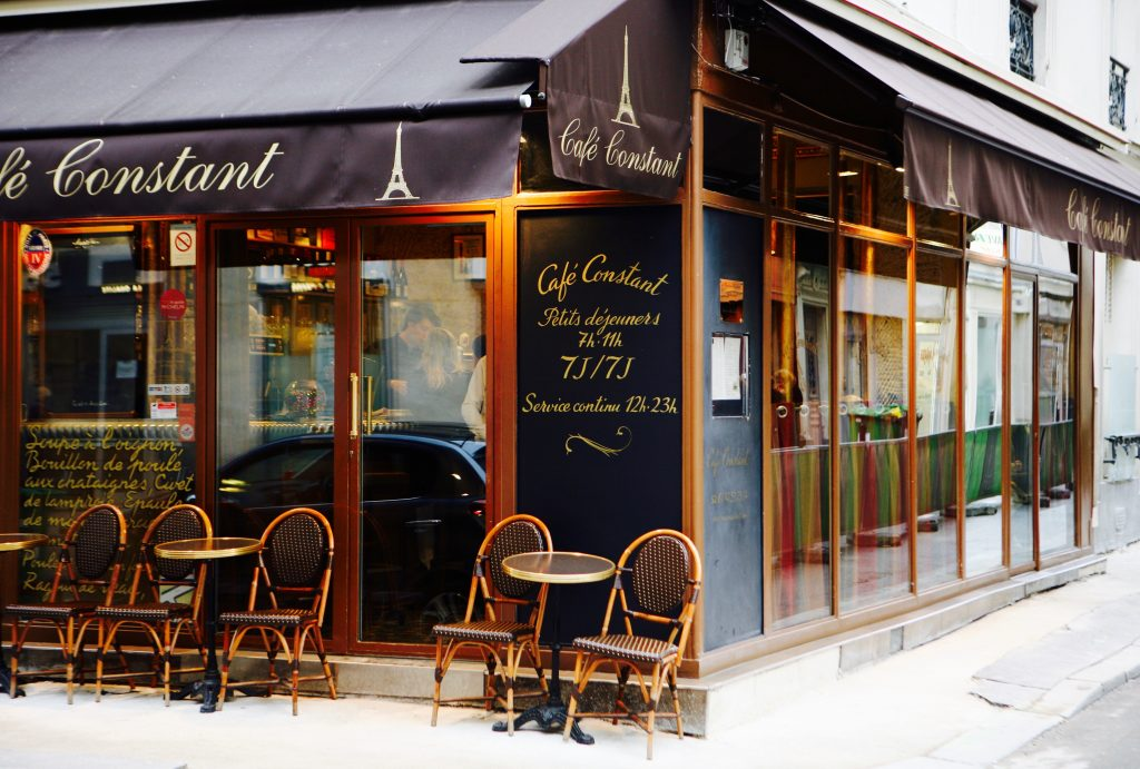 Tables and chairs outside a Paris bistro