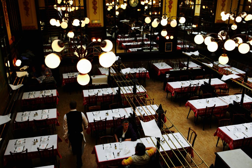 Rows of tables in a dining room in Paris