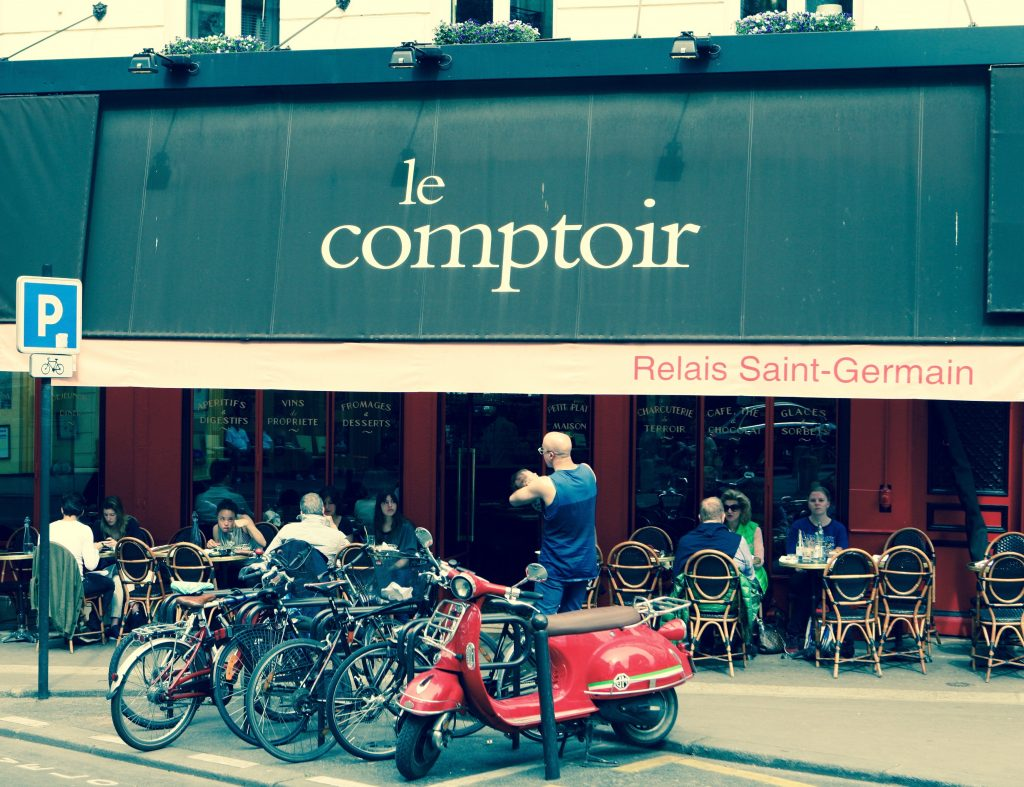 Collection of bicycles outside a Paris bistro
