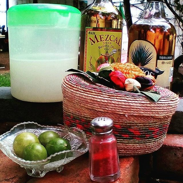 lime, salt, and bottles of mezcal and tequila
