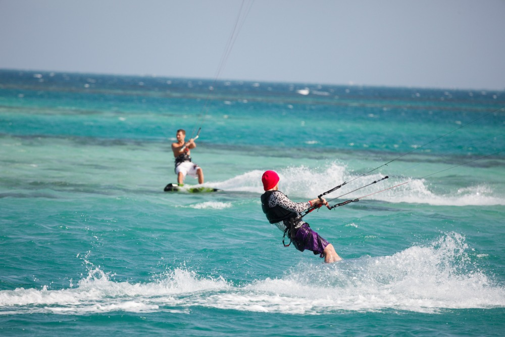 kitesurfers on the water in Dahab
