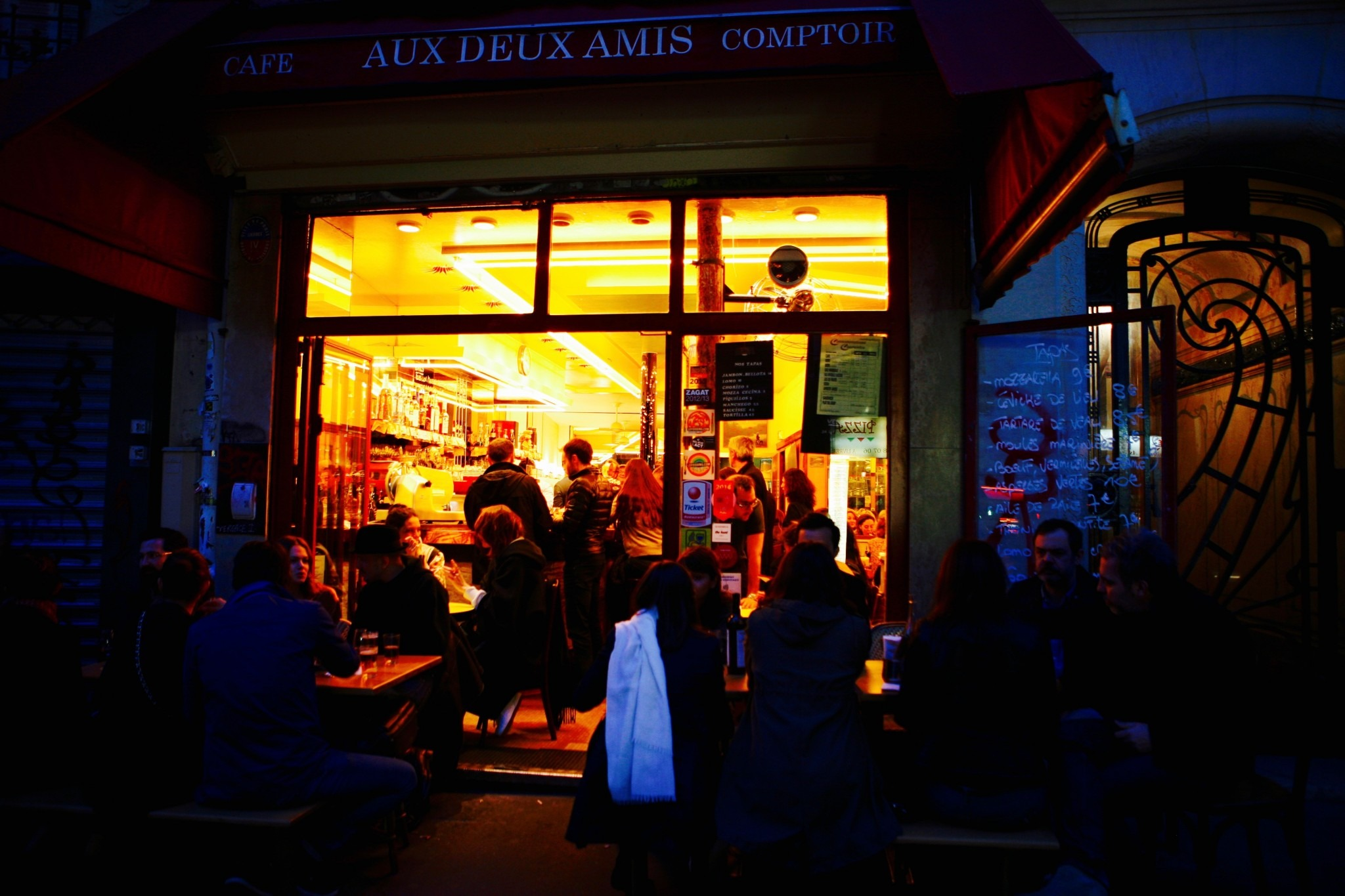 exterior of neo-bistrot at night in Paris