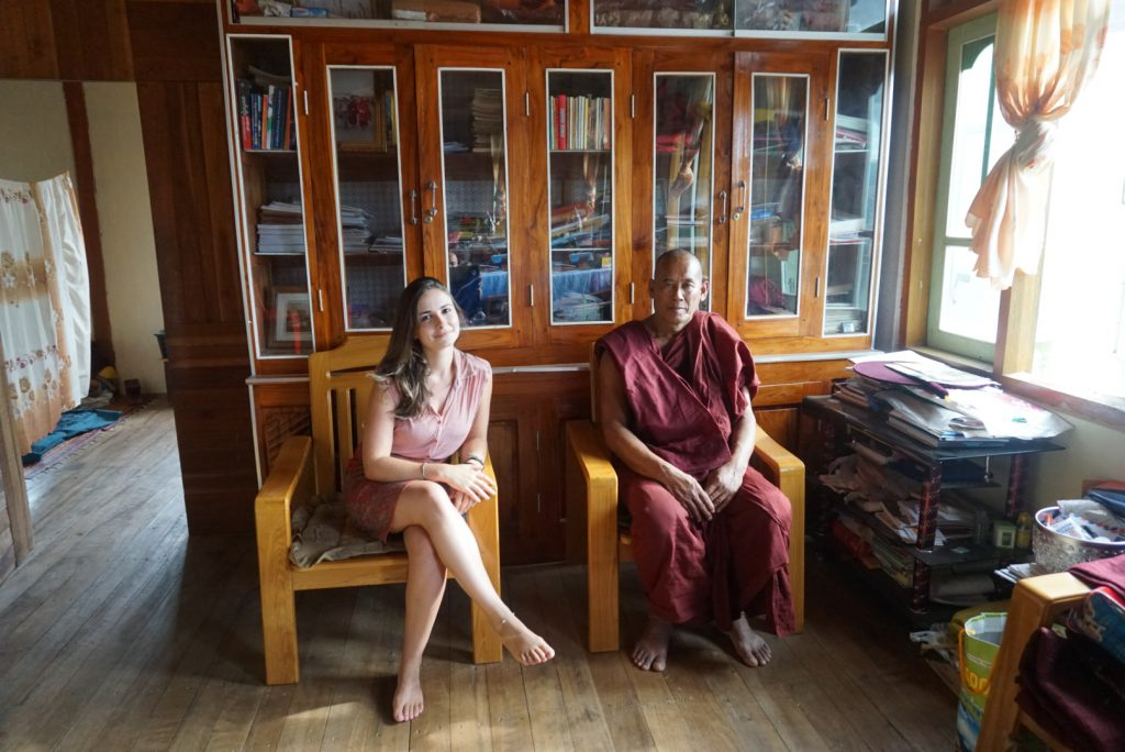 traveller and monk sitting together in Myanmar