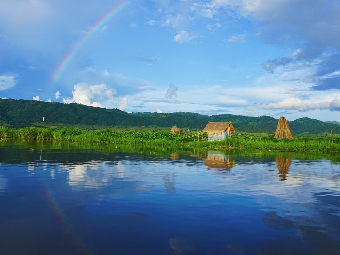 rainbow over a lake in Myanmar