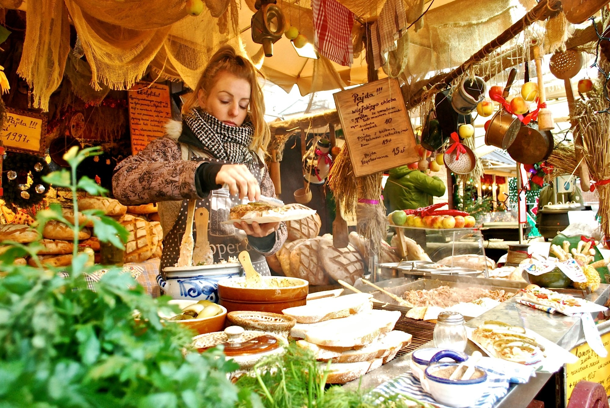 local serving food at a Krakow Christmas market