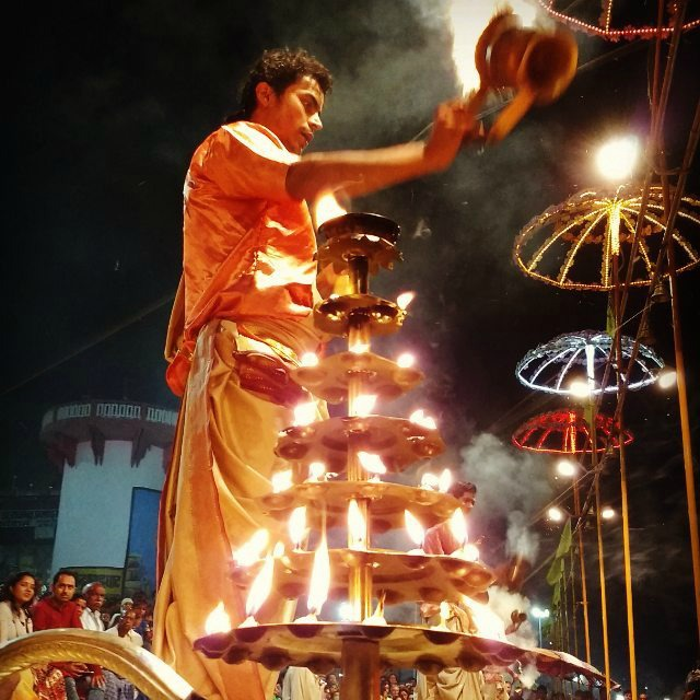 ganga aarta performer with candles in Varanasi
