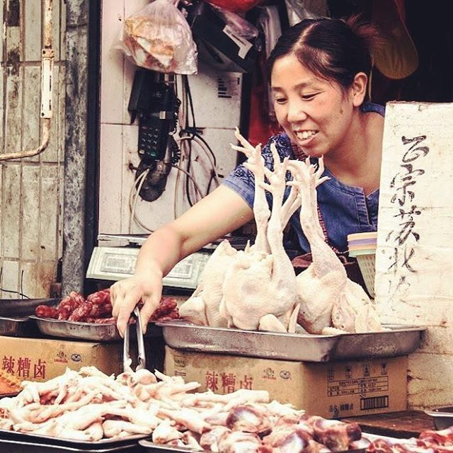 woman selling chickens on the street in Shanghai