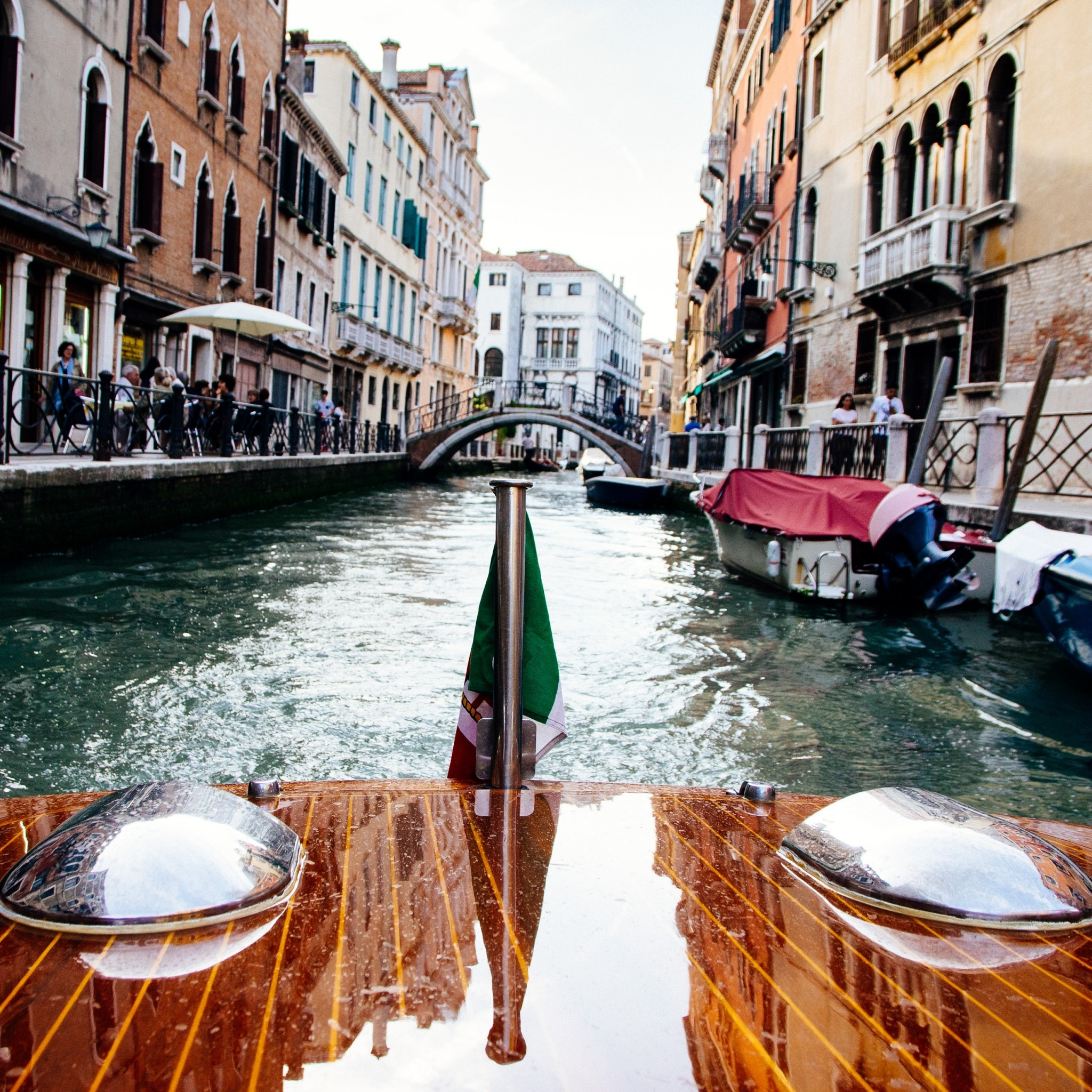 looking out the front of a boat on a canal in Venice