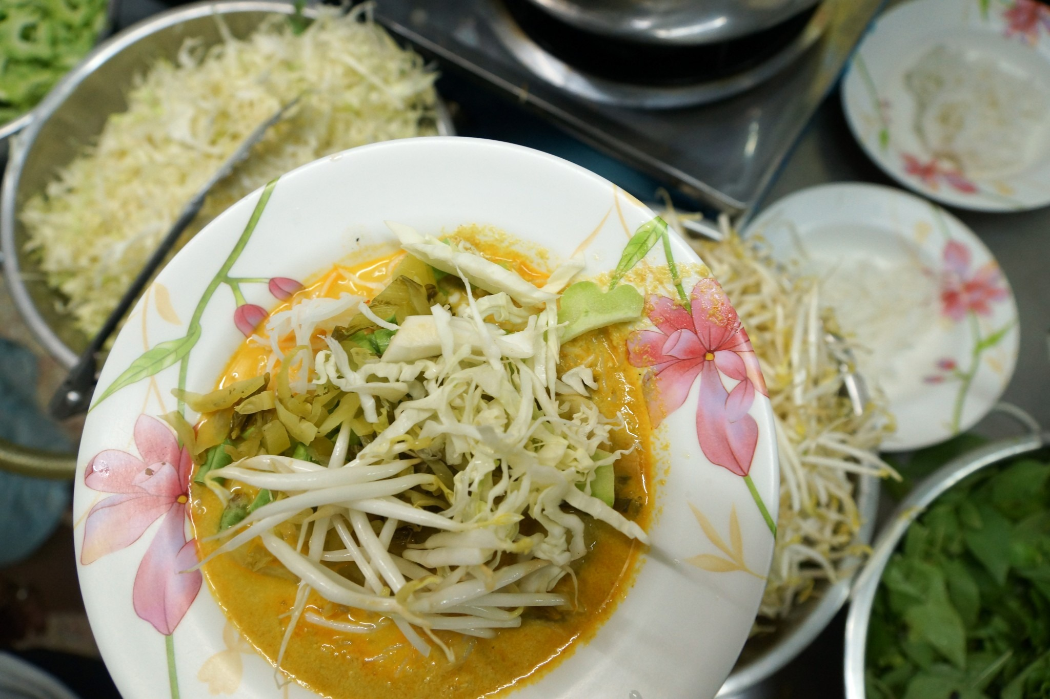 bowl of fermented noodles with curry sauce and vegetables