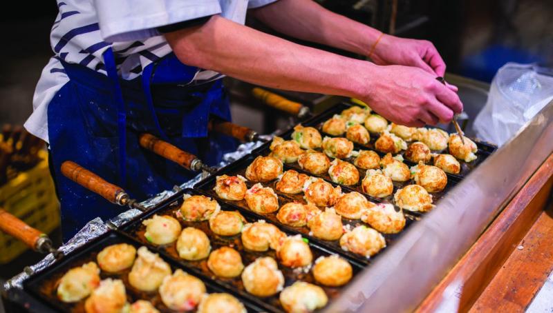 local making takoyaki balls in Osaka