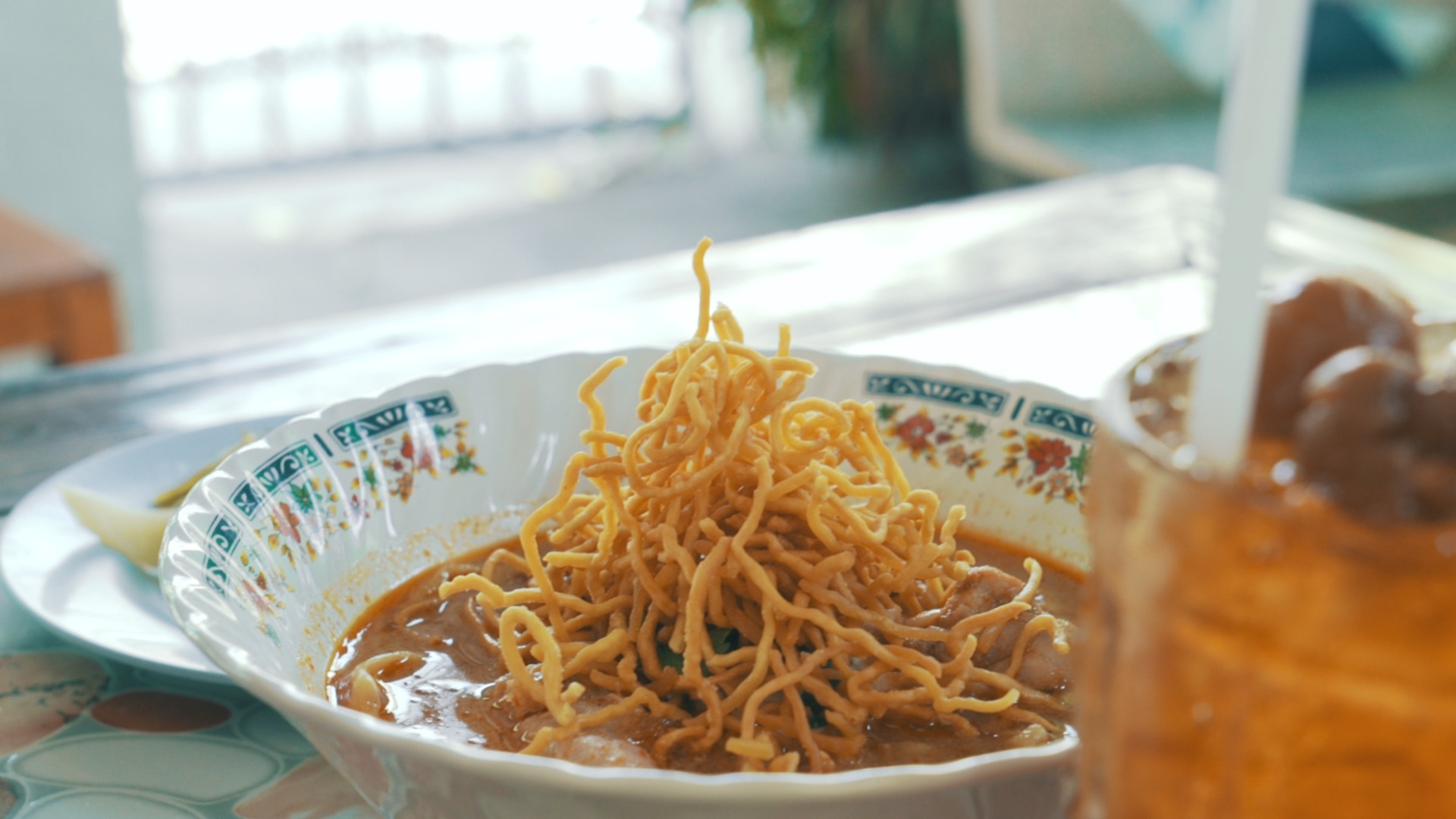 close-up of yellow curry noodle soup