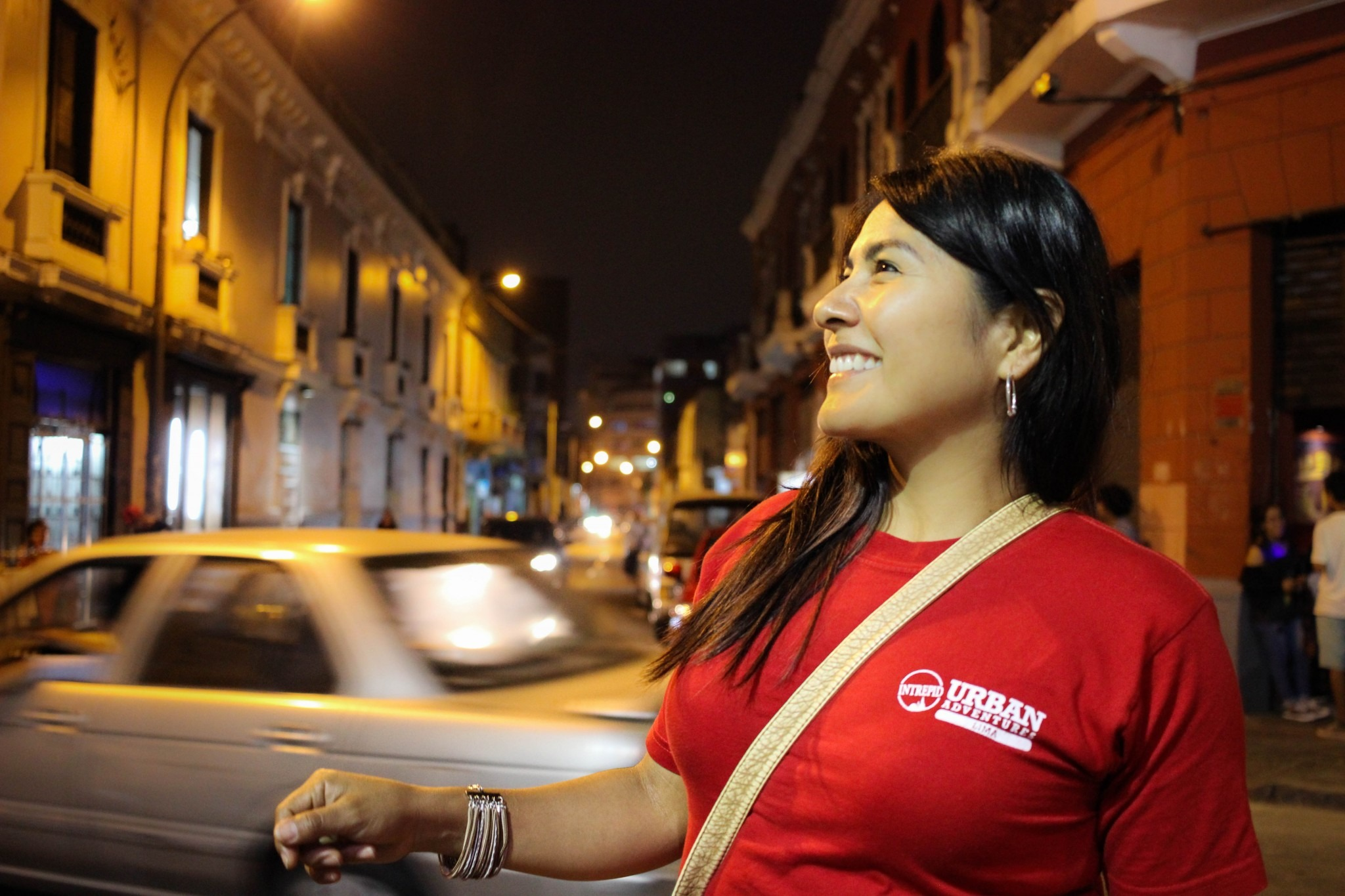 woman on a busy nighttime street in Lima