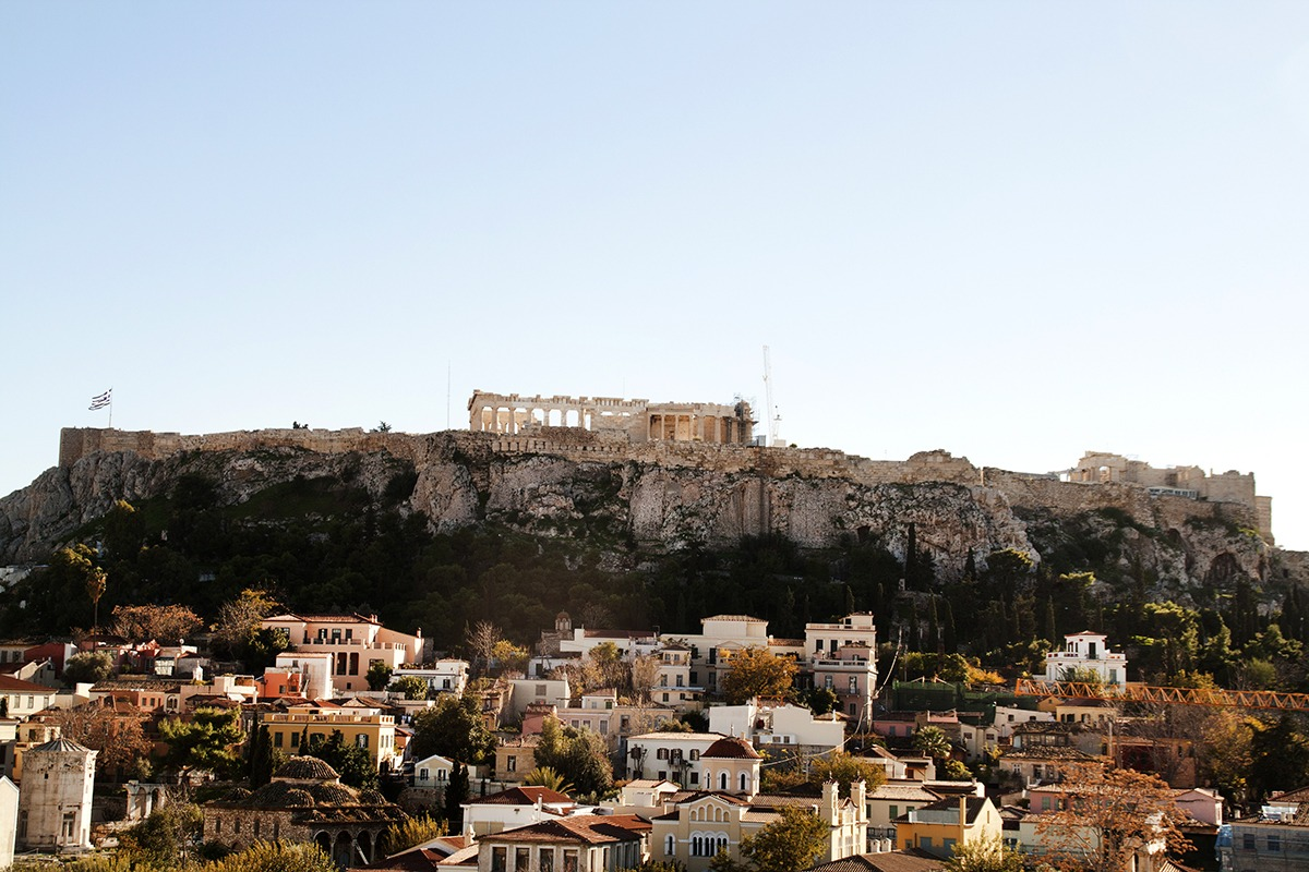 view of the Acropolis across the city in Athens