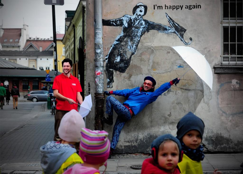 Kazimierz's street art might inspire you to get a bit silly | Photo by Marek Piątkowski