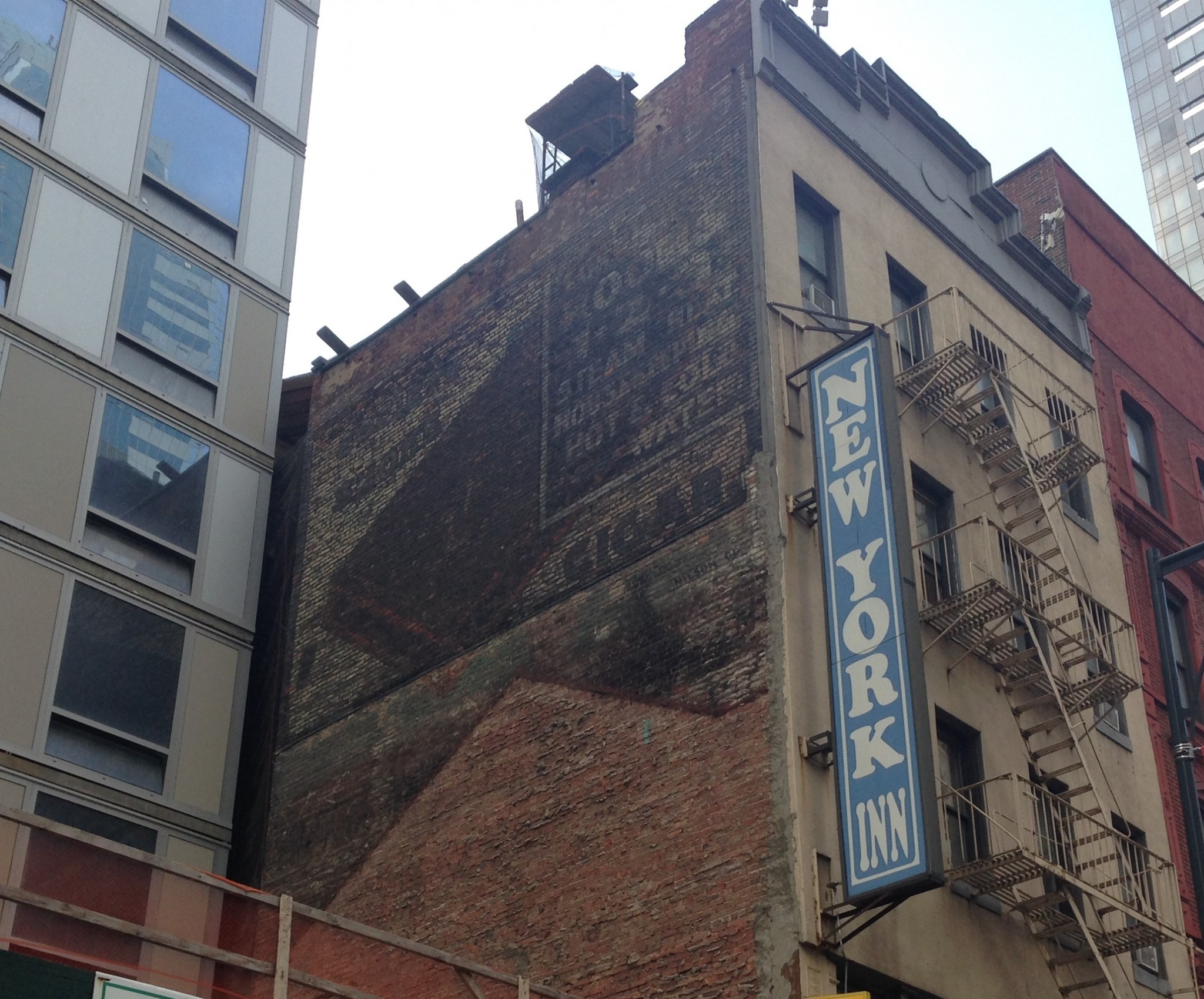 faded sign on the side of an NYC building