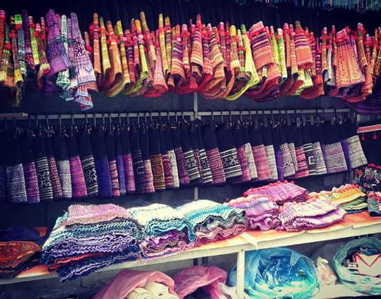 rows of coloured fabric on display in Chiang Mai