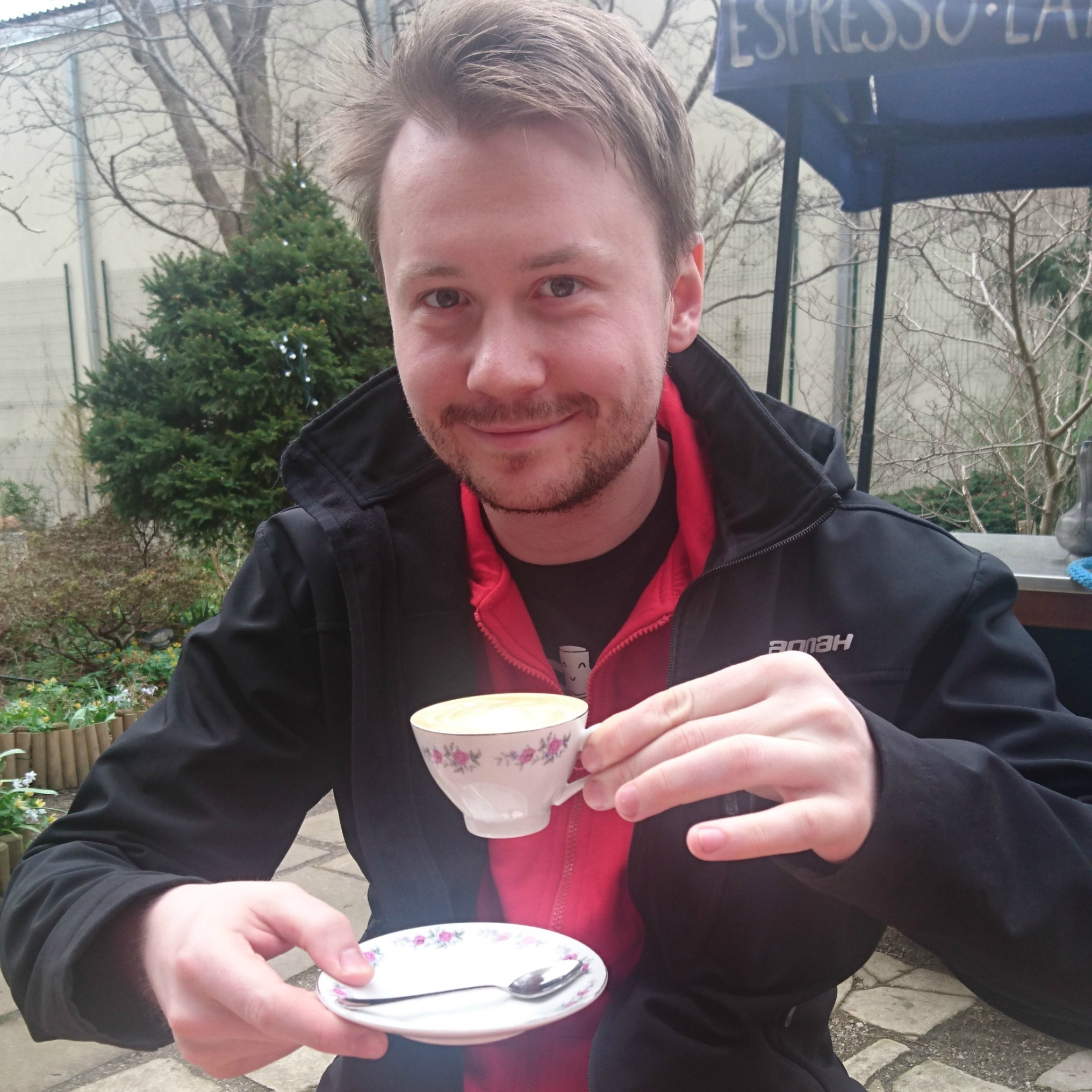 Lukas drinking a coffee in Prague