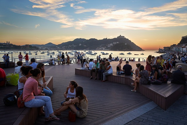 locals gathered by the water in San Sebastian