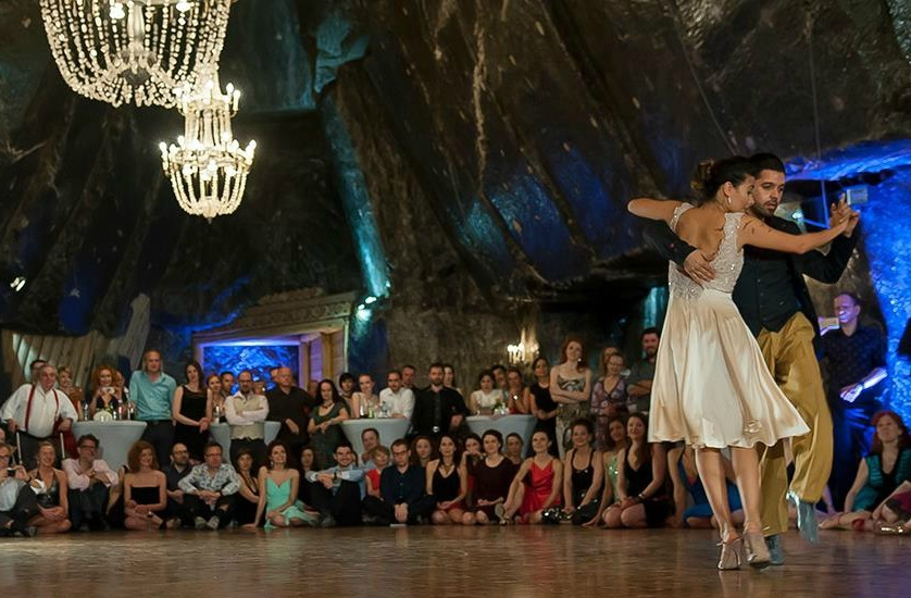 tango dancers in a ballroom