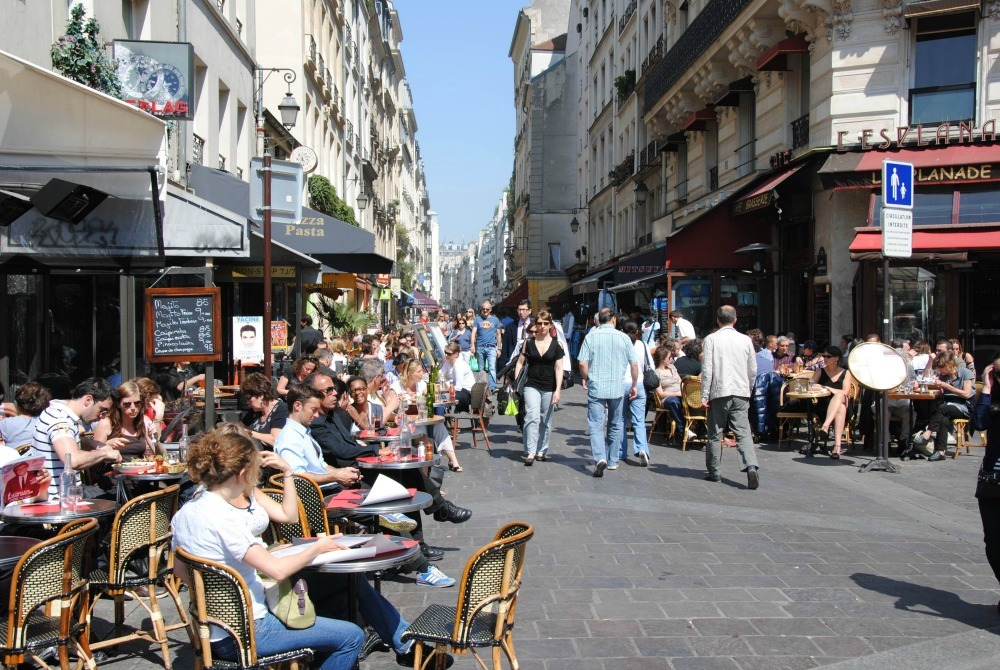 people on a sunny street in Paris