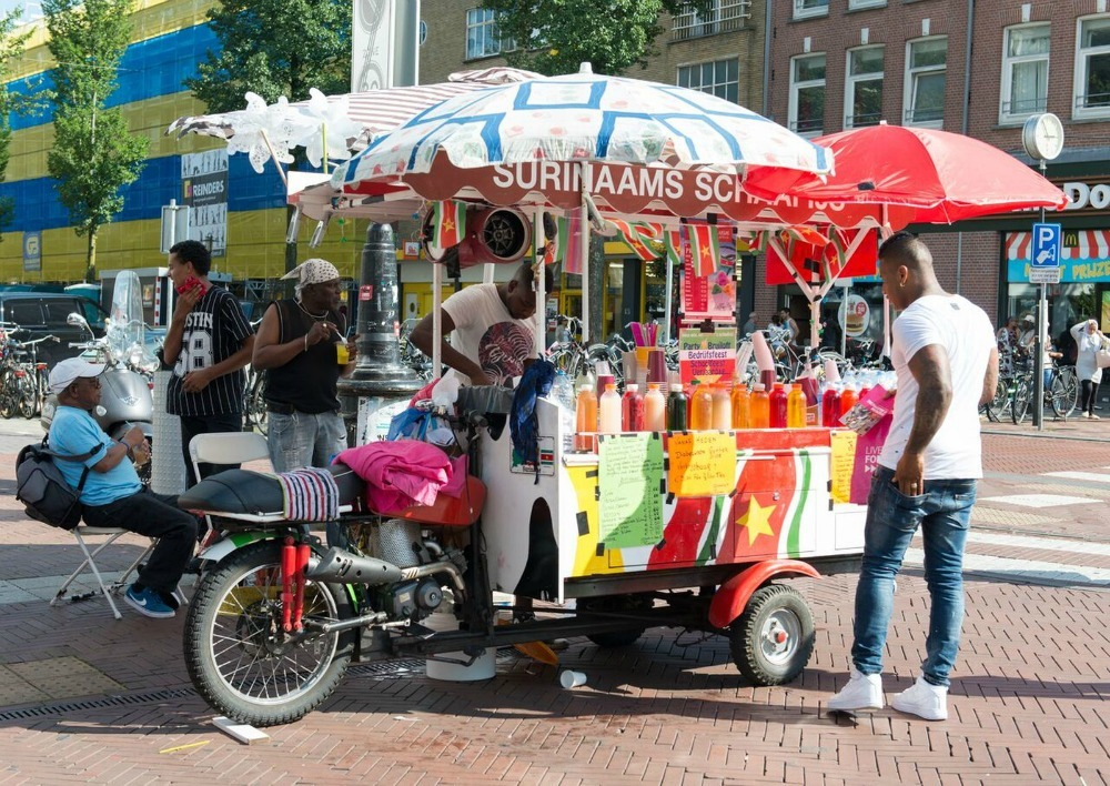 street food stand selling Surinamese food
