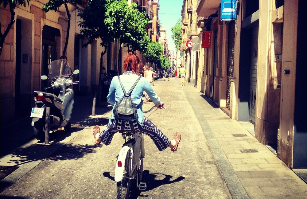 girl riding a bike in Barcelona