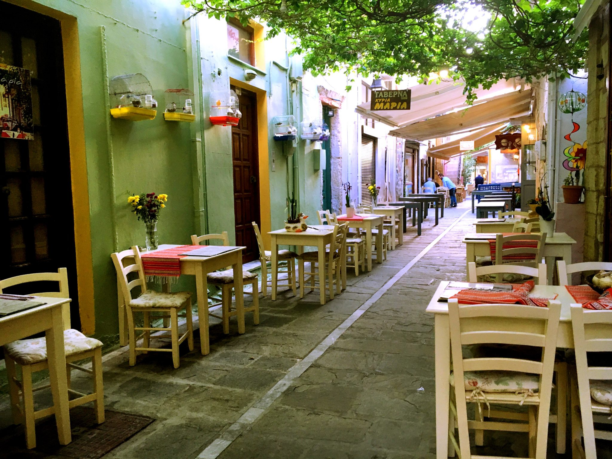tables and chairs at a Crete cafe