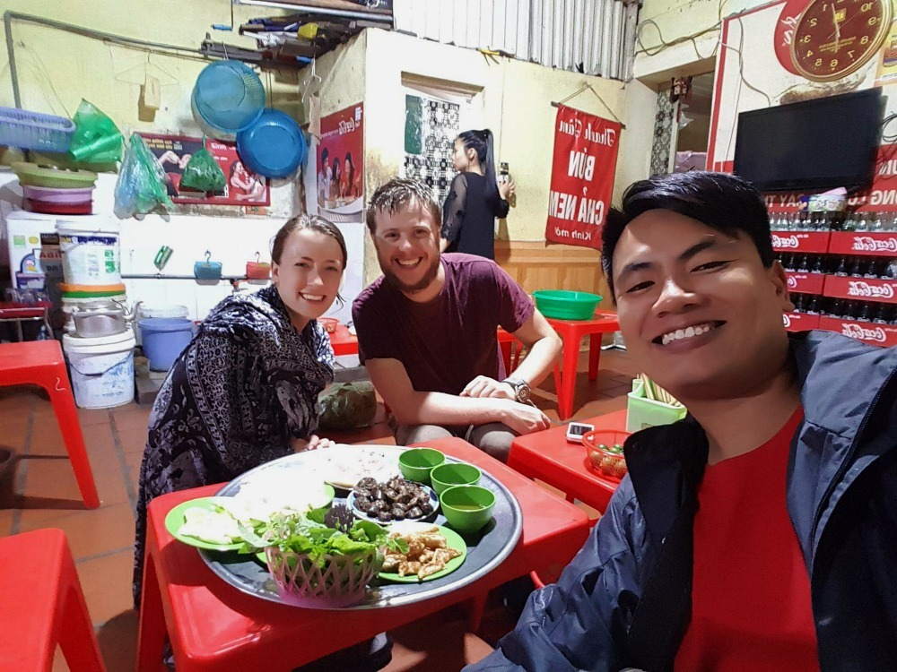 travellers and tour guide in a Hanoi cafe