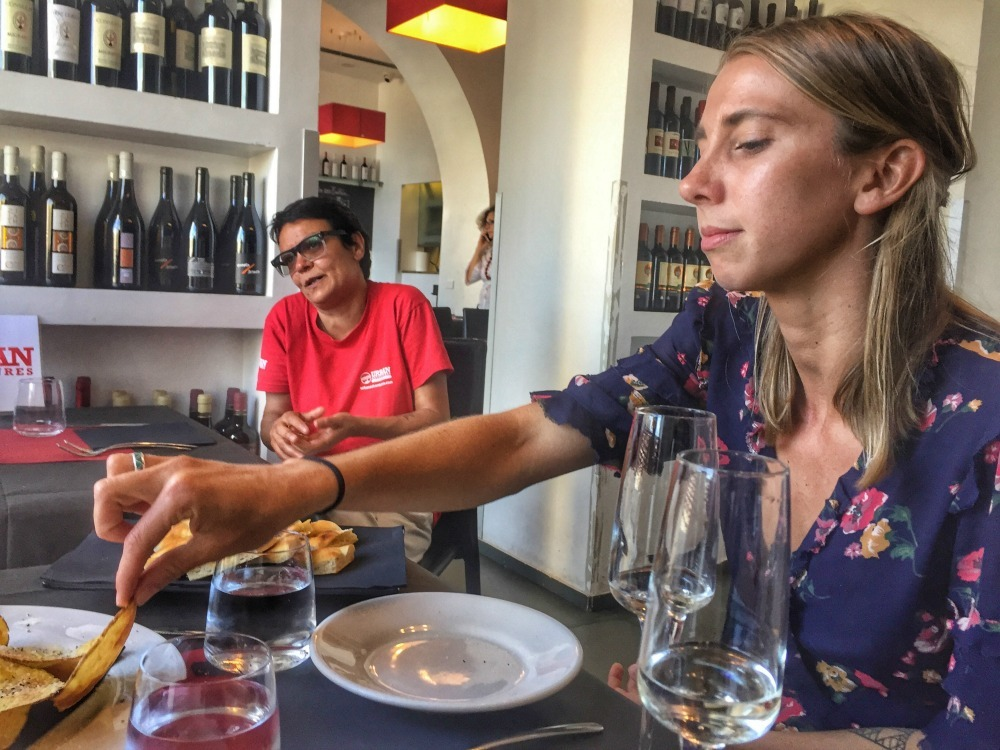 traveller with a tour guide at a wine tasting