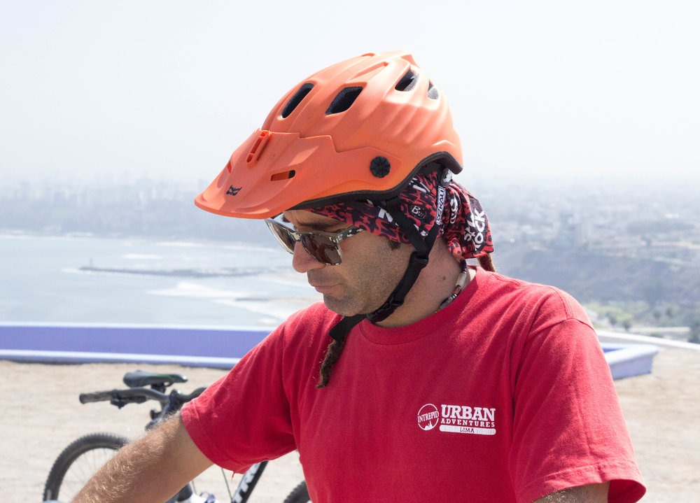 close-up of tour guide wearing a bike helmet