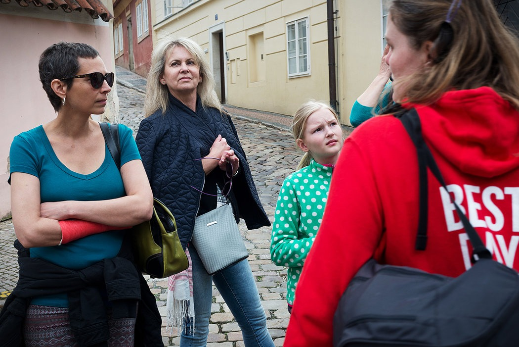 travellers with a tour guide in Prague