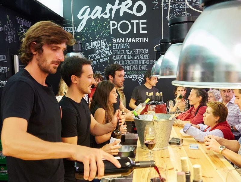 bartenders serving locals in San Sebastian