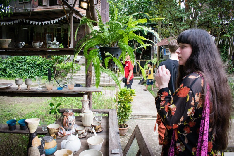 female traveller looking at pottery in Chiang Mai