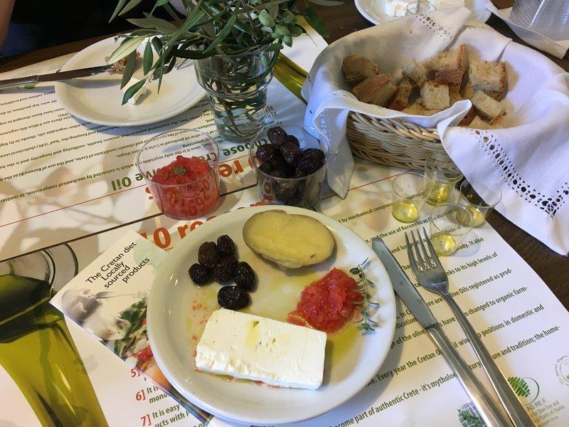 platter of feta, olives, tomato and olive oil