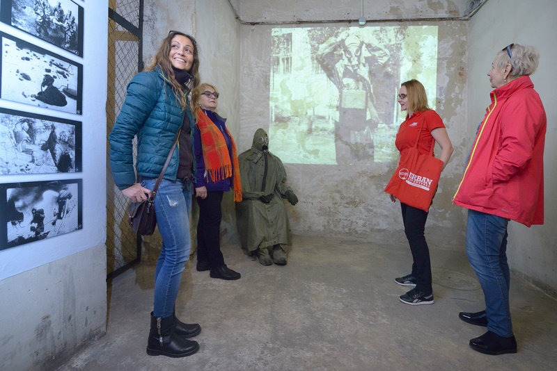 travellers and tour guide in a bunker in Krakow