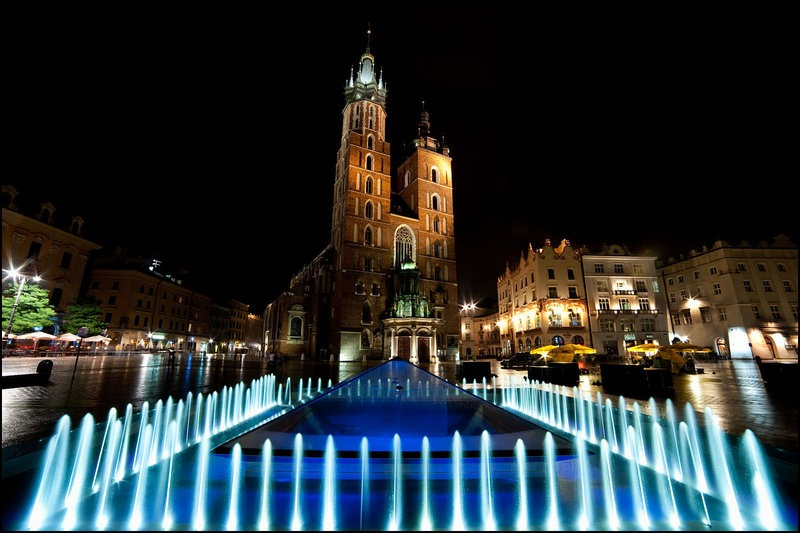 the main square of Krakow lit up at night