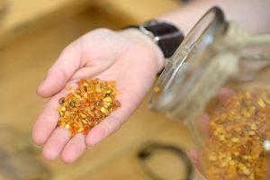hand holding amber beads