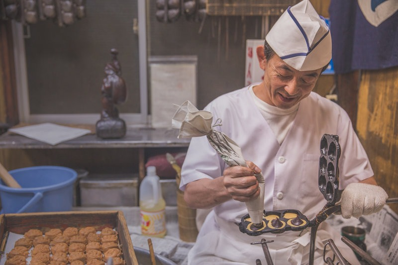 chef making red bean pastries in Tokyo